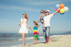 Happy family playing  with balloons on the beach at the day time Royalty Free Stock Photography