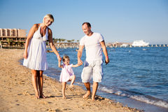 Happy family playing at the beach Royalty Free Stock Photos