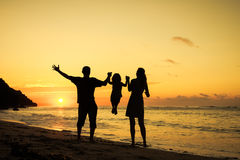 Happy family playing at the beach Stock Photography