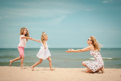Happy family playing at the beach Royalty Free Stock Photography