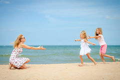 Happy family playing at the beach Royalty Free Stock Image