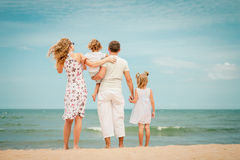 Happy family playing at the beach Royalty Free Stock Images