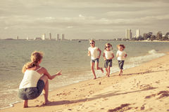 Happy family playing on the beach Royalty Free Stock Images