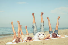 Happy family playing on the beach at the day time. Stock Photography