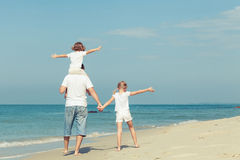Happy family playing  on the beach at the day time. Royalty Free Stock Photography