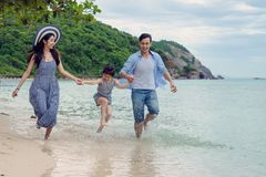 Happy family playing on the beach at the day time stock photography