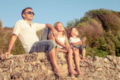 Happy family playing  on the beach at the day time. Stock Images