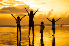 Happy family playing at the beach Royalty Free Stock Photo