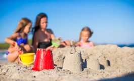 Happy family playing with beach toys during Royalty Free Stock Photography