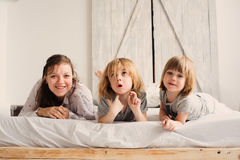 Happy family playing in bedroom in the morning Royalty Free Stock Photos