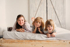 Happy family playing in bedroom in the morning Stock Photo