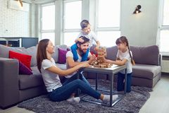 Free Happy Family Playing Board Games At Home. Stock Image - 121135171