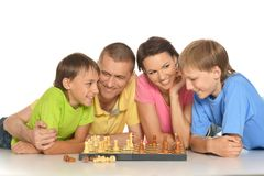Happy Family Playing Chess Stock Photos