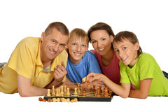Happy family playing chess Royalty Free Stock Photos