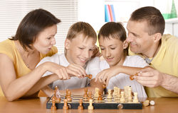Happy family playing chess Stock Photography