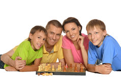 Happy family playing chess Royalty Free Stock Photo