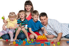 Happy family are playing on the floor Stock Photo