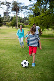Happy family playing football in park Royalty Free Stock Photography