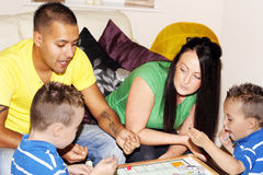 Happy family playing games. Happy family spending quality time together playing games Royalty Free Stock Photography
