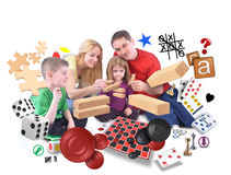 Happy Family Playing Games Together on White. A happy family is playing with various games of puzzles, blocks and checkers on an isolated white background stock photography