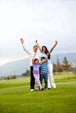 Happy family playing golf Royalty Free Stock Image