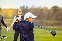 Happy family is playing golf in autumn royalty free stock image