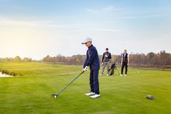 Happy family is playing golf in autumn royalty free stock photography