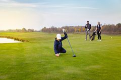 Happy family is playing golf in autumn stock image