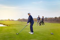 Happy family is playing golf in autumn royalty free stock photos