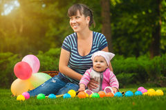 Happy family are playing on the green grass Stock Image