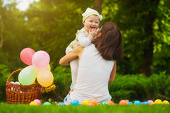 Happy family are playing on the green grass Stock Photo