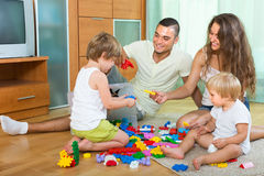 Happy family playing in home interior royalty free stock photo