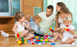 Happy family playing in home interior Royalty Free Stock Images