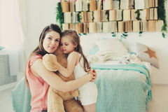 Happy family playing at home. Mother and toddler daughter relaxing and having fun in bed Stock Photography