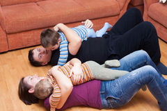 Happy family playing at home Stock Photos