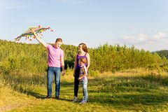 Family playing with a kite Stock Photos