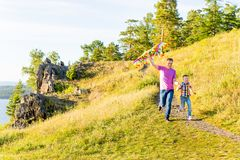 Family playing with a kite Royalty Free Stock Photography