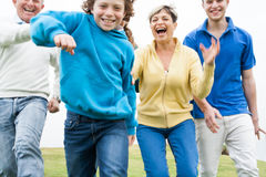 Happy family playing on lawn Royalty Free Stock Photos