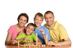 Happy family playing lotto Royalty Free Stock Photo