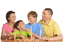Happy family playing lotto Royalty Free Stock Photography