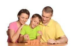 Happy family playing lotto Royalty Free Stock Photos