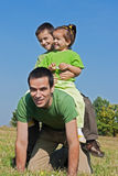Happy family playing on the meadow Stock Image