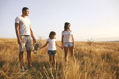 Happy family playing on nature in summer at sunset. stock photography