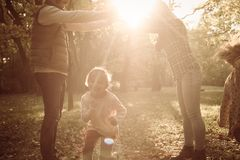 Happy family playing in nature. royalty free stock photography