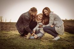 Happy family playing outdoor. Family enjoying together in nature stock photography