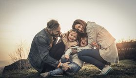 Happy family playing outdoor. Family enjoying together in nature royalty free stock photography