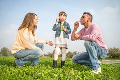 Happy family playing outdoors stock photography