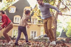Happy family playing outside. On the move. royalty free stock image