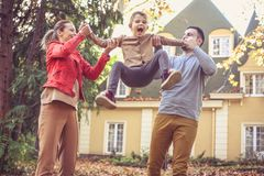 Happy family playing outside. On the move. Stock Images