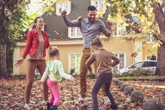 Happy family playing outside. Parents with daughters. stock photography